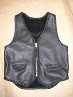 "This black leather vest was built for a guy to use with his motorcycle. It features two hip slit pockets and a (YKK #10) brass zipper. It also has, what I call, a back draft flap ...which is a 3"" extension of the bottom/back. If you click on the link to this picture, you'll go to other better views of it's features."