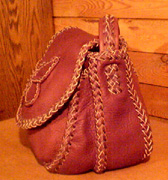 This picture is a side view of the purse showing a good look at the different braids it is made with.