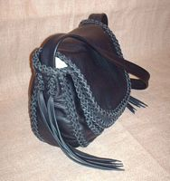 This side view of the purse provides a good view of the braided construction and shows a different angle of the many kinds of braid it is put together with.