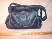 "This picture is of the purse with ruler in front of it to help realize the  12.5"" wide by 9"" high size of it."