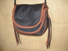 "The strap on this bag is not braided ...and it has no applique on the flap. The tassels hanging from the straps ends are quite long ...around 12""."