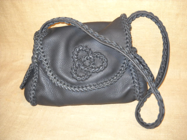 Here is another purse of this style that has (what I call) a tri-loop applique on the flap. I was also flattered by what she wrote to me and what she put in her blog about the purse.