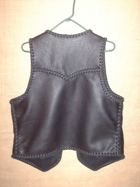 A view of the back of this vest offering a better look at the pointed yoke.
