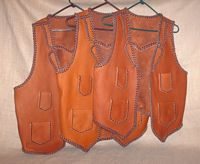 These three two toned vests were all bought by the same guy for his bartender employees. They all have split lapels, pointed yokes on the back, as well as, the four pockets done with a simple braid. The picture is linked to a page with several more pictures of the previously mentioned features.