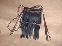fringed leather bag with a braided strap.