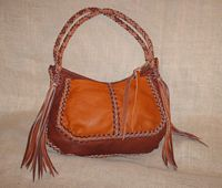 Two straps with very long fringe, and pockets on each side, are features of this two-toned bag.