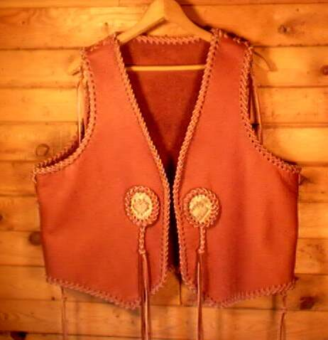 This custom leather vest was made for a guy who sent me his vest to go by to build one for him. He also supplied the snake skin for the inlay. I rather did the side and top seams free hand, as well as the braiding around the snake skin.