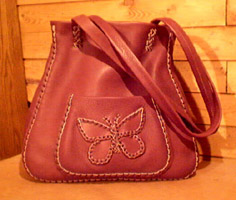 large leather tote bags braided - this one wih a butterfly applique