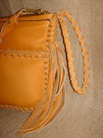 This picture shows the strap fastened with the tassels hanging.