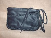This is a picture of a Black clutch purse similar to the others on this page.