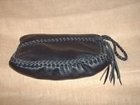 Here is a picture of this clutch purse lying on its back showing how the back gathers to the front for dimension.