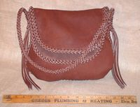 A front view of this handmade moccasin cowhide leather purse.