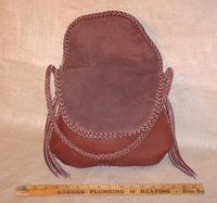 A look at the purse with one flap raised for access.