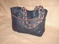 "This Black tote was built using two tone (Black and Mahogany) 1/4"" wide laces of the same material it was built with. It has 8 strand round braided straps (without tassels)."