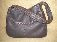 This dark Brown tote is different by the fact that it has just one shoulder strap. Other than that, it has the two front pockets and inside back pocket that most of these totes have.