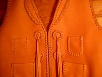 cowboy leather vest conchoes or concho's. How is it spelled? :)