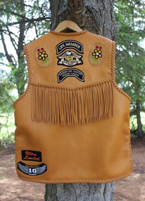 leather vest with fringe and bead work