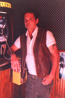 Mike wearing his braided leather vest with the long lapels