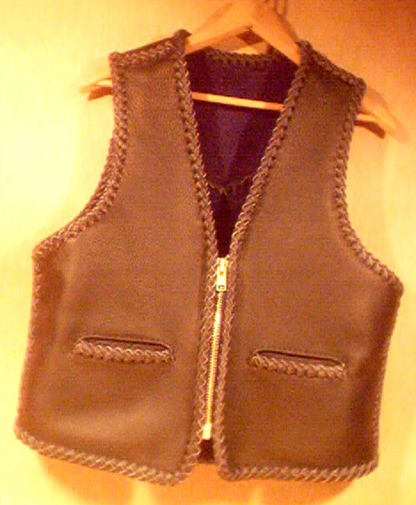 This black leather vest had slit pockets and a large brass (YKK #10) zipper. It has a back pointed yoke and unlike the majority of my vest, the bottom is squared off around its whole length. I probably added a zipper pullafter the picture was taken.