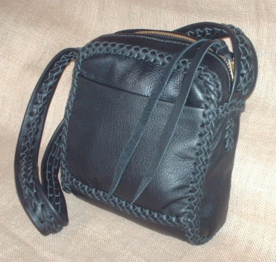 a messenger bag built using braided leather