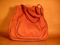 This large Rust colored tote was also braided with a more elaborate braid. It has another pocket on the back of it just like the one seen here on the front of it.