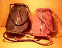 unique leather handbags with large brass zippers