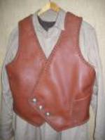 I fashioned this braided leather vest after a picture that a guy want somewhat duplicated. It has the pocket you see in this picture and another similar pocket on the inside - same location. It has the three buttons that the buyer supplied. Clicking the link of this picture brings you to a picture of the receiver wearing it and the small picture of what he wanted this vest like. There also some testimonial words about it from him.